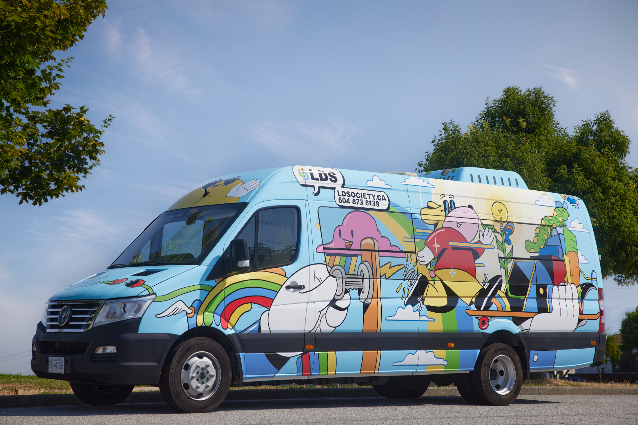 The LDS Access bus is baby blue with a bright, colourful graphic on the sides and back.