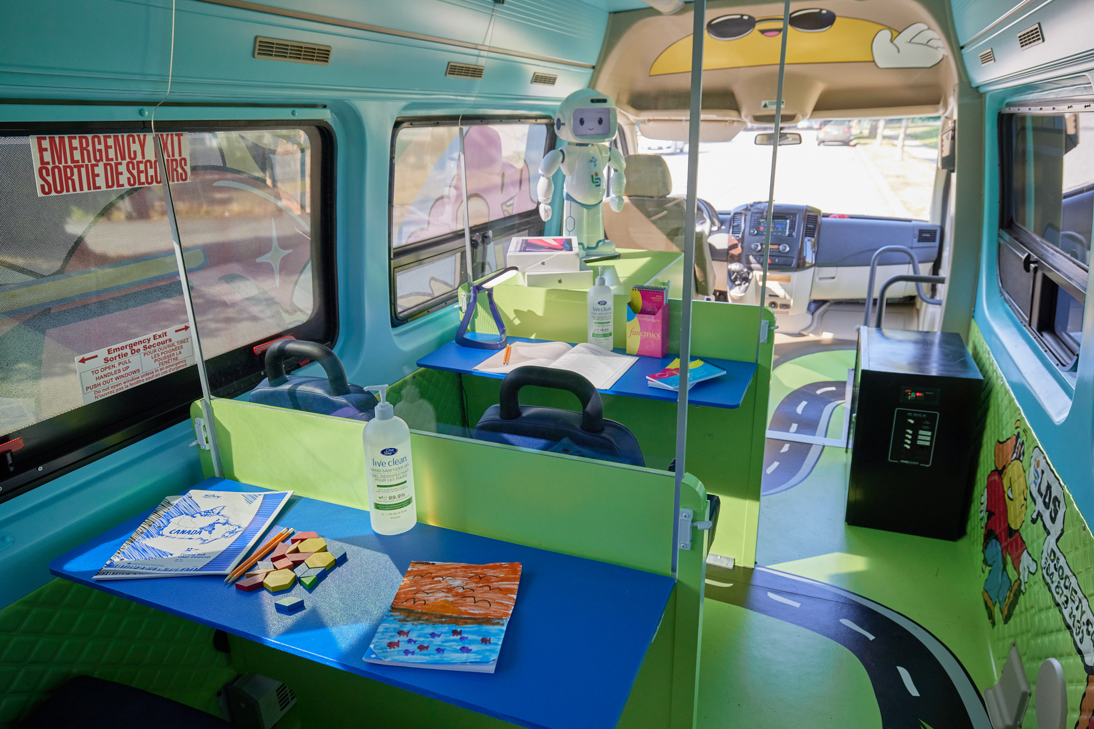 The interior of LDS Access contains three bright blue and green teaching stations